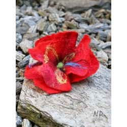 A red women's brooch, hand-felted in the form of a flower with the possibility of pinning the hair