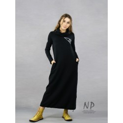 Black knitted turtleneck dress decorated with a hand-painted face
