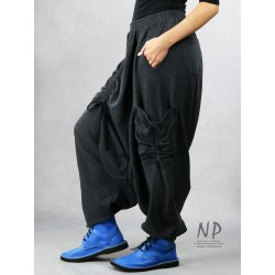 Gray women's pants with a low crotch and an elastic band, made of warm sweatshirt fabric