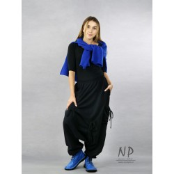 Black women's pants with a low crotch and an elastic band, made of warm sweatshirt fabric
