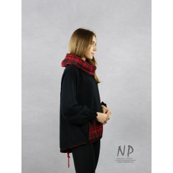 A knitted sweatshirt with an elongated back, a large woolen turtleneck with a check pattern and wide sleeves