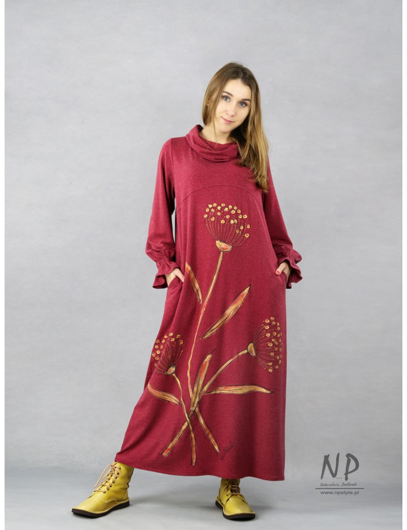 Burgundy knitted turtleneck dress decorated with hand-painted flowers.