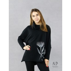 Black oversize women's blouse with an asymmetrical hem, decorated with hand-painted patterns.