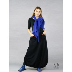 Black long knitted skirt with an elastic band with adjustable length.