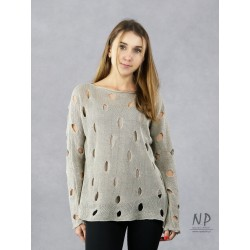 A linen sweater with holes for women in the color of natural linen.