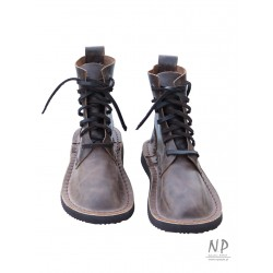 Basic 7 handmade leather hiking boots, laced with a strap.