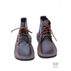 Brown, handmade leather Basic 5 hiking boots, laced with a strap.