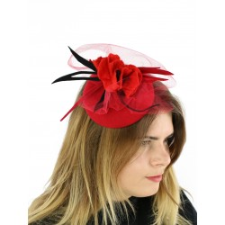 Red fascinator hat with a veil