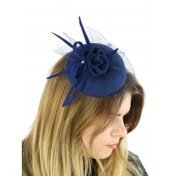 Navy blue fascinator hat with a veil