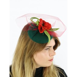 Green fascinator hat with a veil