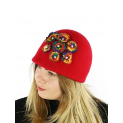 Red toque decorated with felted flowers