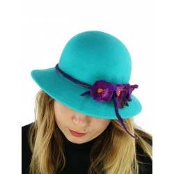 A felt hat with a large turquoise brim.