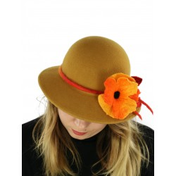 A felt hat with a large brim in honey color, decorated with felted flowers.