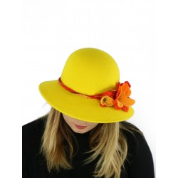 A felt hat with a large yellow brim, decorated with felted flowers.