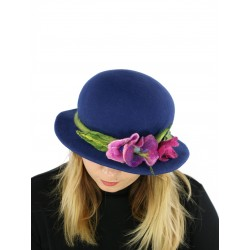 A navy blue felt hat with a small brim, decorated with a sprig of flowers