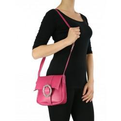 Small pink leather handbag sewn by hand